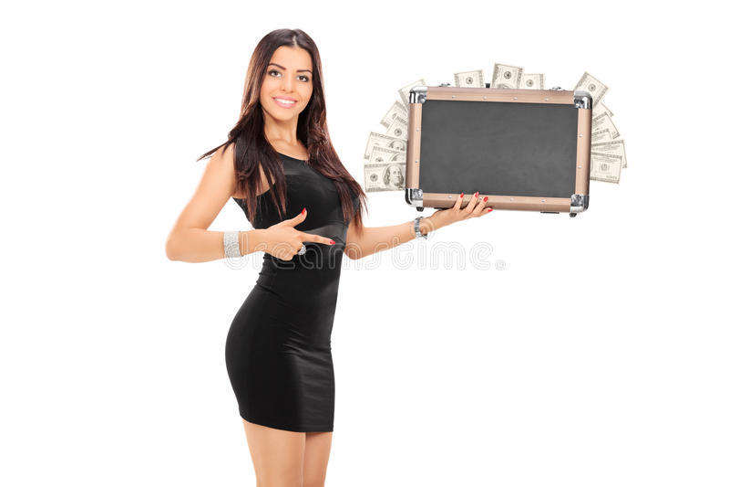Elegant woman holding a bag full of money royalty free stock photo