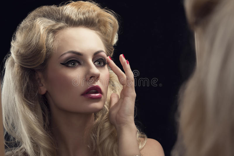Hair Style Girl Image: Elegant Woman Looking In The Mirror Stock Photo