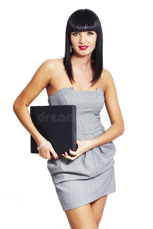 Elegant woman with notebook. Isolated, vertical stock photo