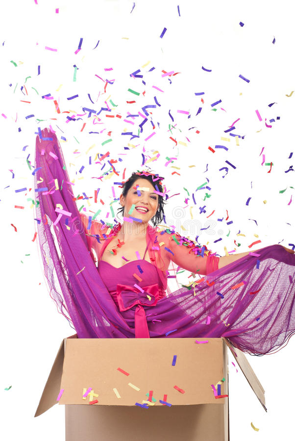 Elegant woman out of the box. At new year party midnight and many confetti falling down over her royalty free stock image