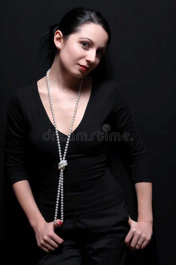 Elegant woman with pearls stock image