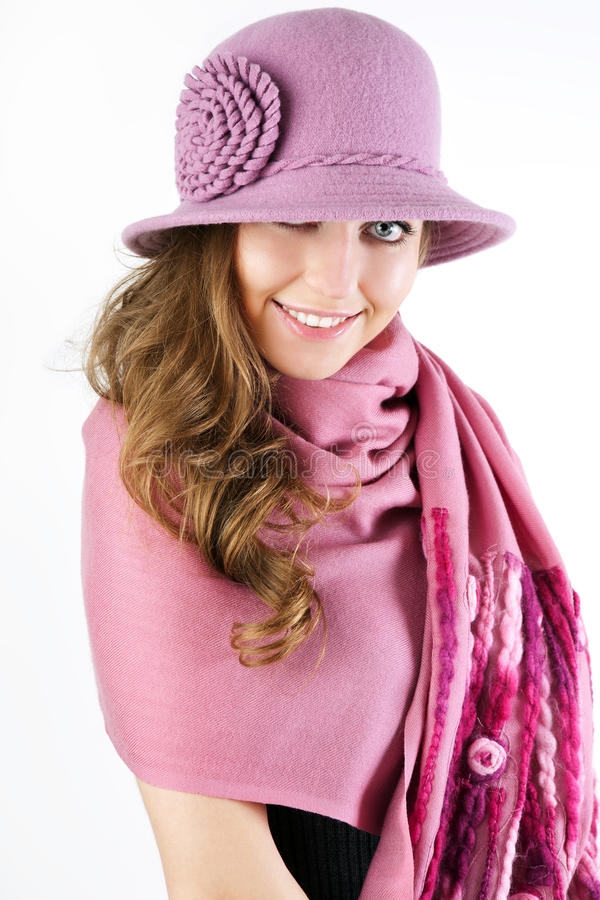 Elegant woman is in a pink hat and scarf. royalty free stock image