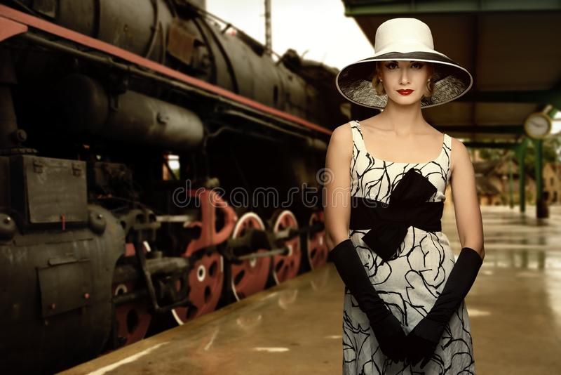 Elegant woman on railway station royalty free stock image