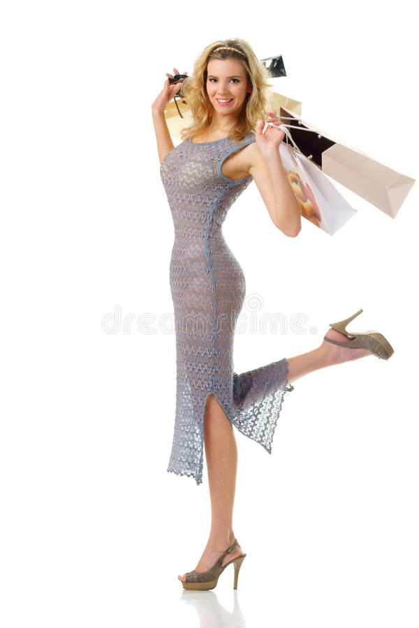 Elegant woman with shopping bags looking at you stock photo