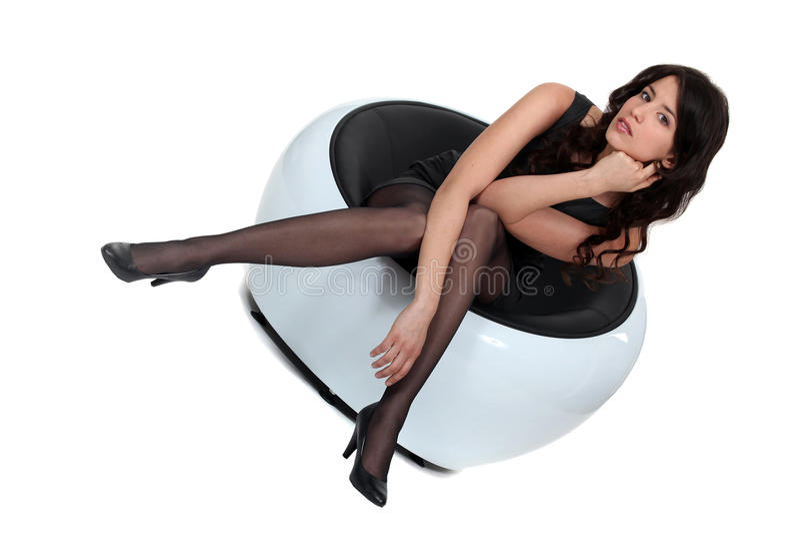 Elegant woman sitting royalty free stock photo