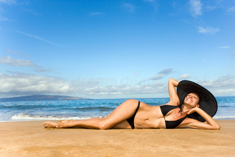 Elegant woman smiling on beach royalty free stock photo