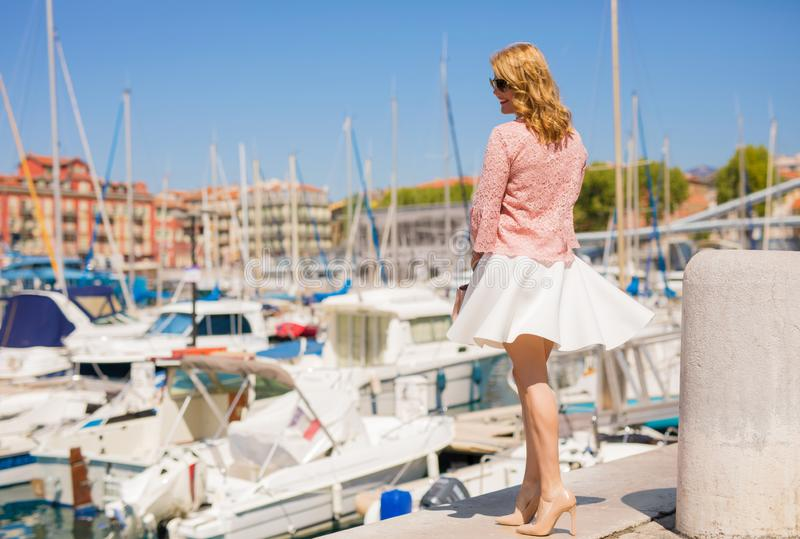 Elegant woman standing in yacht port stock images