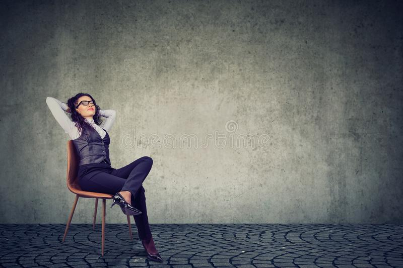 Relaxed businesswoman resting on chair stock photography