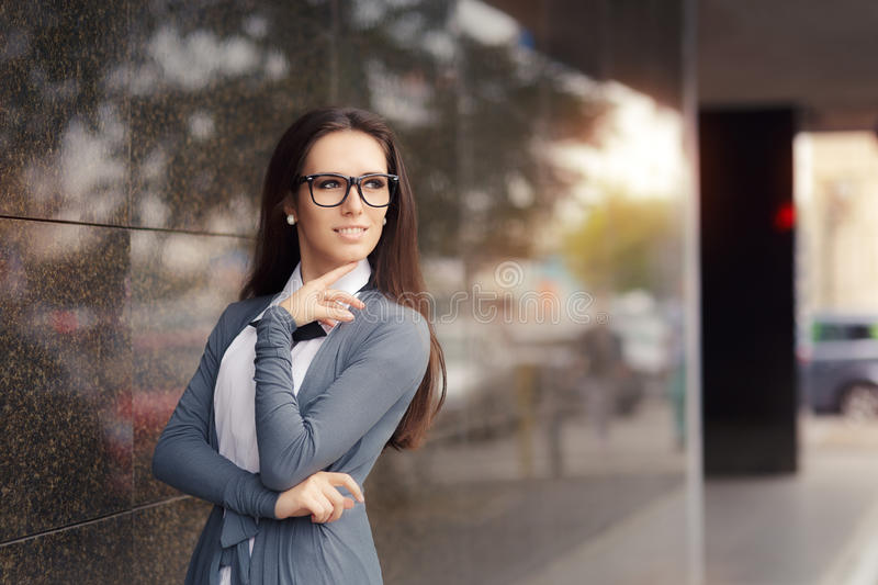 Elegant Woman Wearing Glasses Standing Out in The City royalty free stock photo