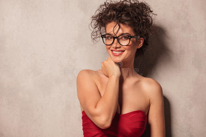 Elegant woman wearing a red dress and glasses. stock photography