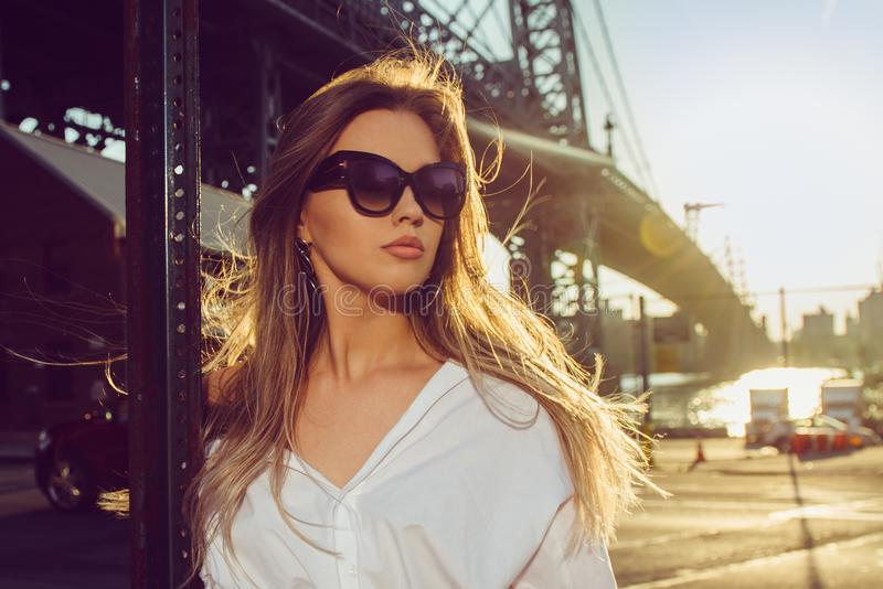 Elegant woman wearing sunglasses in the city at hot summer dayÑŽ. Elegant woman wearing sunglasses in the city at hot summer day stock photography