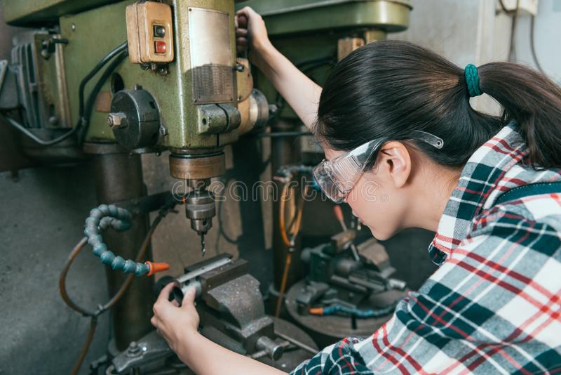 Elegant woman worker wearing safety goggles stock images