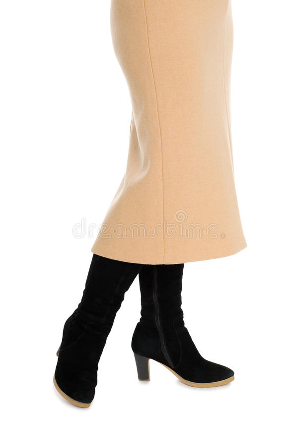 Elegant women's skirt and suede boots. Elegant women's skirt and black suede boots. Isolated on white royalty free stock image