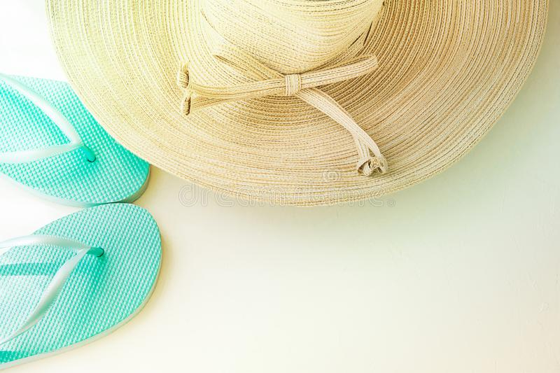 Elegant Women Sun Hat with Bow Blue Beach Slippers on White Background. Seaside Vacation Relaxation. Minimalist Style. Vintage royalty free stock photos