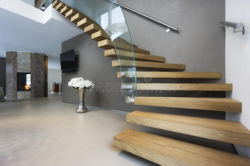 Elegant wood and glass staircase in luxury home. Elegant wood and glass staircase in luxury house stock images