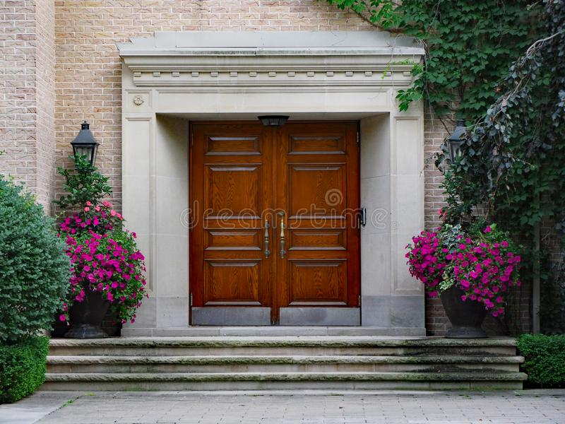 Elegant wooden front door and portico entrance royalty free stock photos