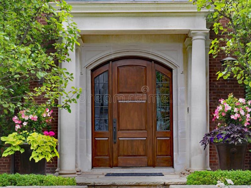 Elegant wooden front door royalty free stock photography