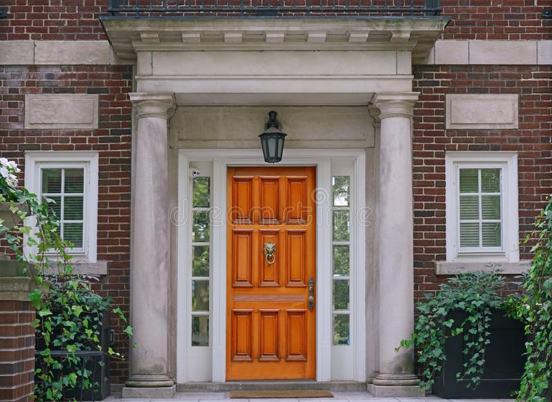 Elegant wooden front door and stone columns royalty free stock photos