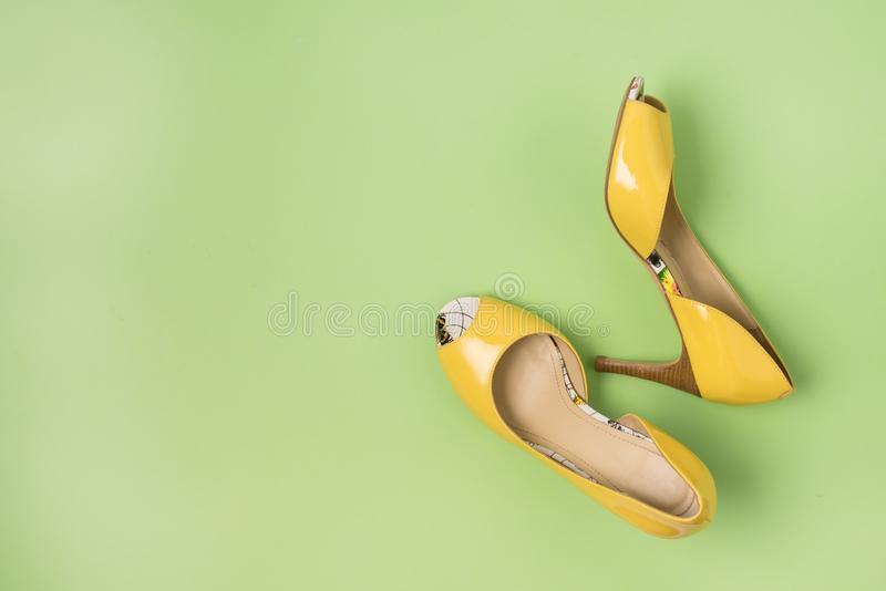 Elegant Yellow Female Leather Shoes on Summer Green Background Flat Lay Top Vew Copy Spac Sales Fashion Concept Horizontal Copy stock images