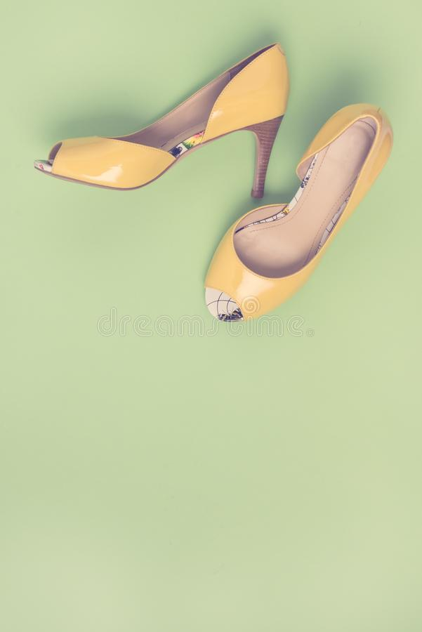 Elegant Yellow Female Leather Shoes on Summer Green Background Flat Lay Top Vew Copy Spac Sales Fashion Concept Vertical.  royalty free stock photos