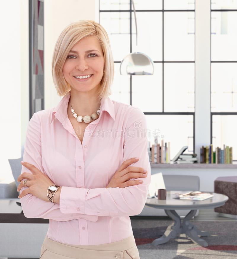 Elegant young blond woman at home royalty free stock photography