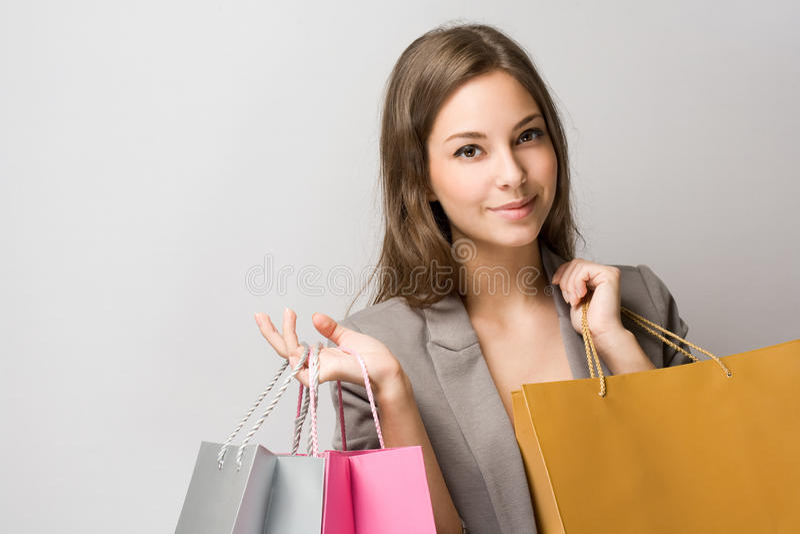 Elegant young brunette shopper. stock photos