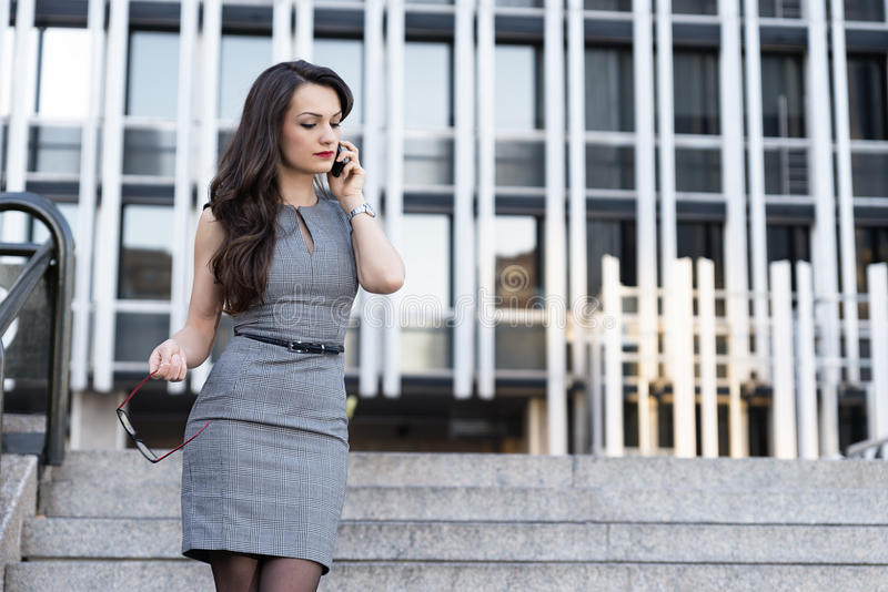 Elegant Young Businesswoman talking by Phone royalty free stock images