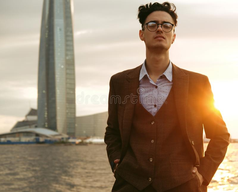 Elegant young handsome man. Outdoors fashion portrait. royalty free stock image