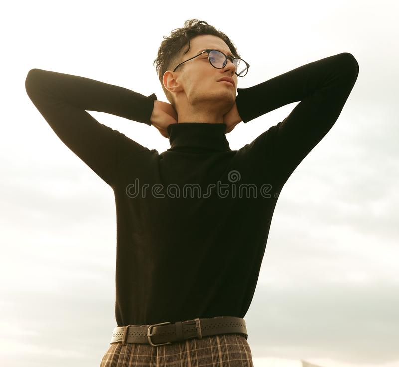 Elegant young handsome man. Outdoors fashion portrait. royalty free stock photography