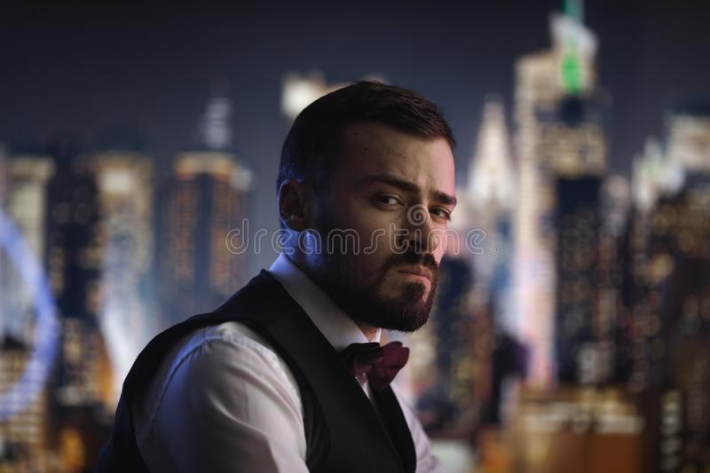 Man in Suit at Night stock photo