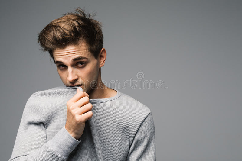 Elegant young handsome man in Studio fashion portrait. royalty free stock image