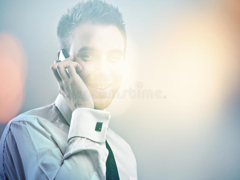 Elegant young handsome model. Multicolored digital painted image portrait of young attractive businessman. royalty free stock photo