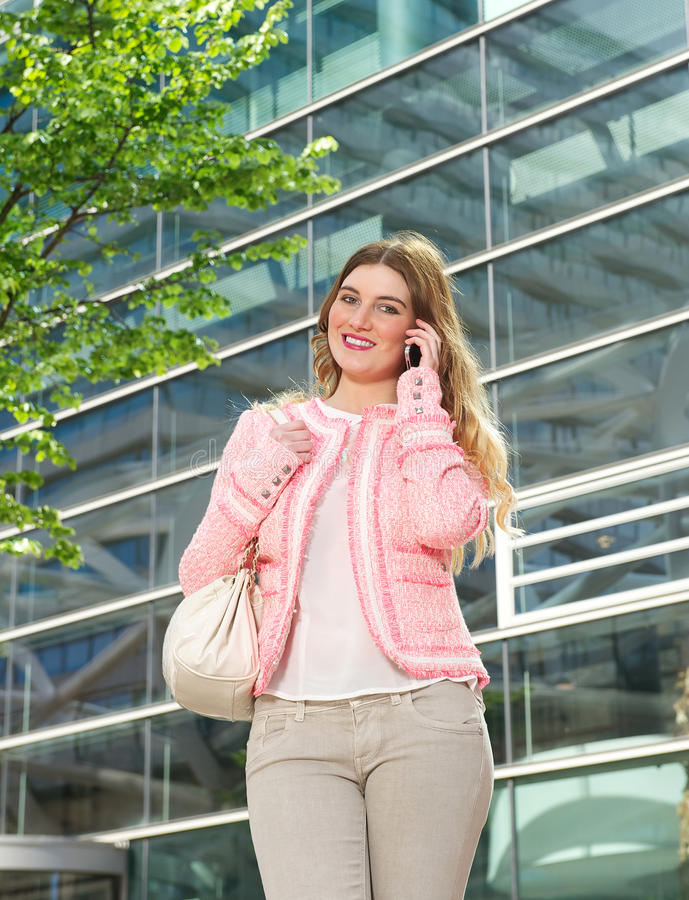 Download Elegant Young Lady Talking On Mobile Phone Outdoors Stock Photo - Image: 31881964