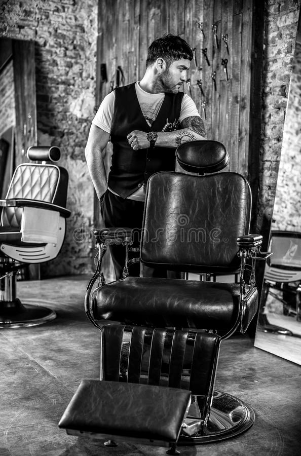 Elegant young man in barbershop. Black-white photo. stock images