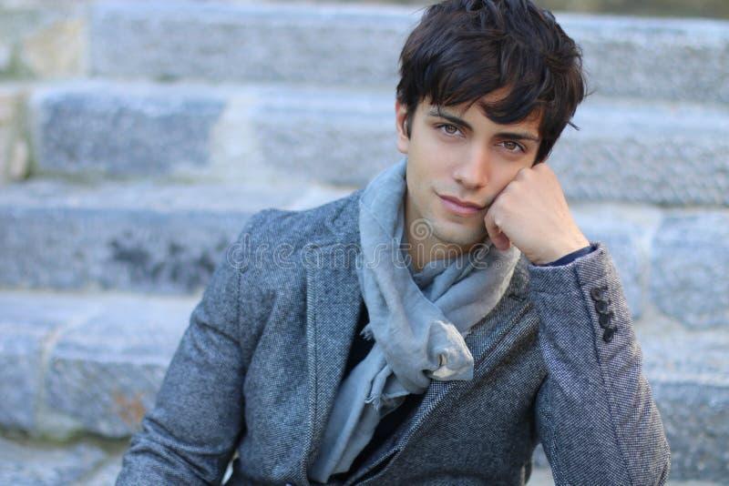 Elegant young man. Handsome elegant man wearing a gray blazer stock images