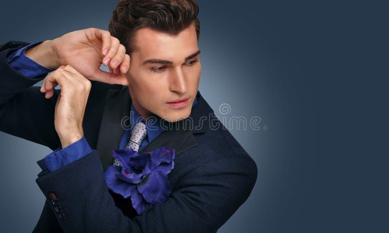 Elegant young man in jacket. Fashion model. royalty free stock photos