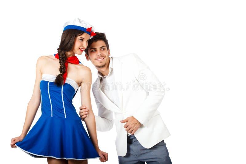 Elegant Young Man And Sailor Woman Looking Away. Stock Photography