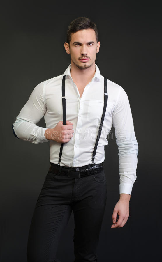 elegant young man with white shirt and suspenders serious expression stock image image of