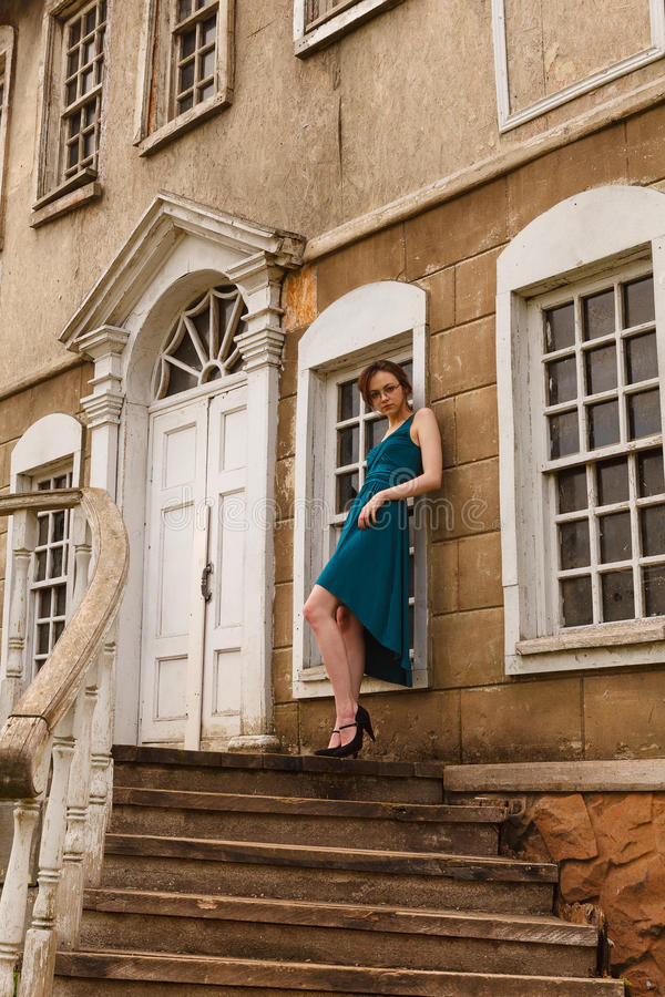 Elegant young woman on stair of an old palace royalty free stock images