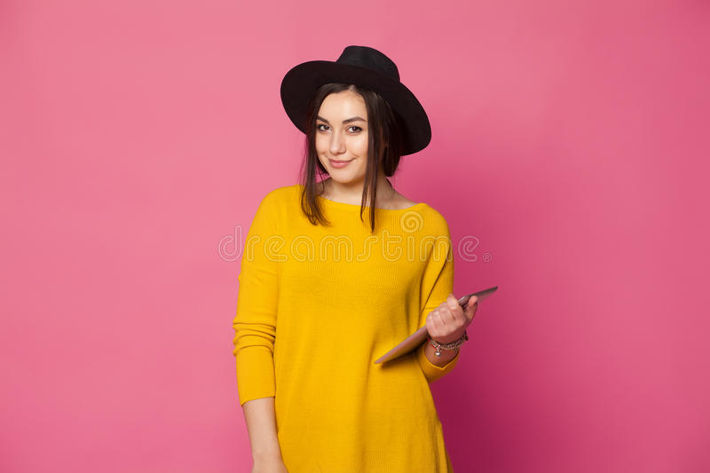 Elegant young woman using tablet stock photo