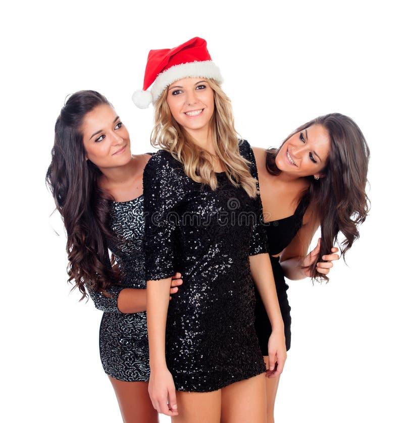 Eleganta kvinnor som firar jul royaltyfria bilder