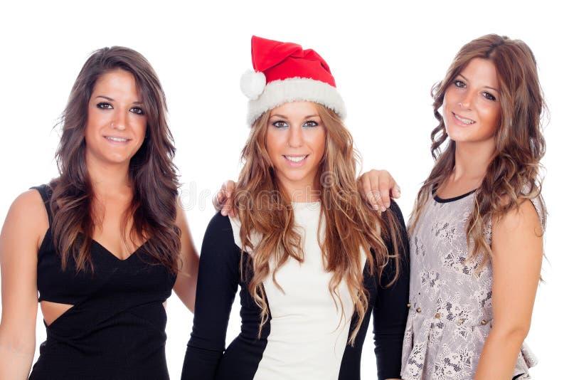 Eleganta kvinnor som firar jul arkivfoto