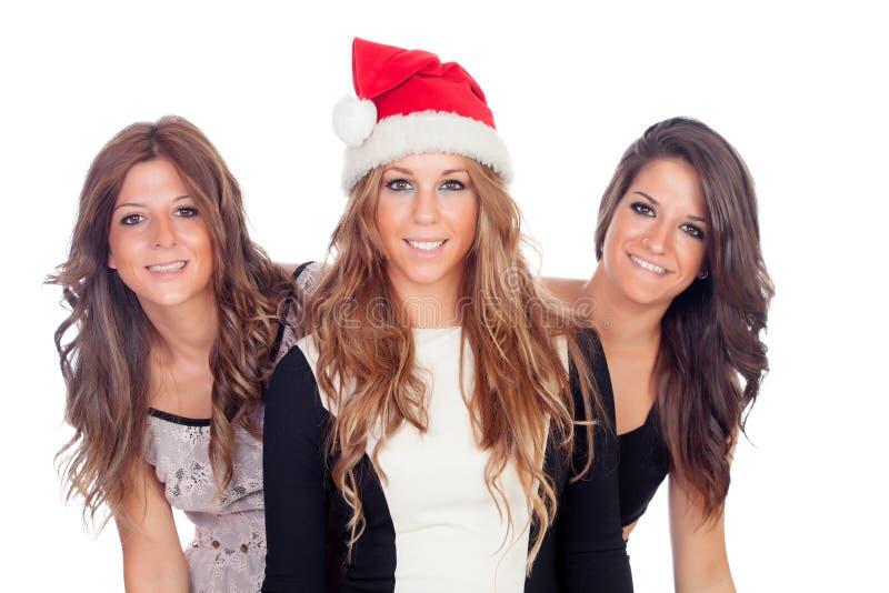 Eleganta kvinnor som firar jul royaltyfria foton