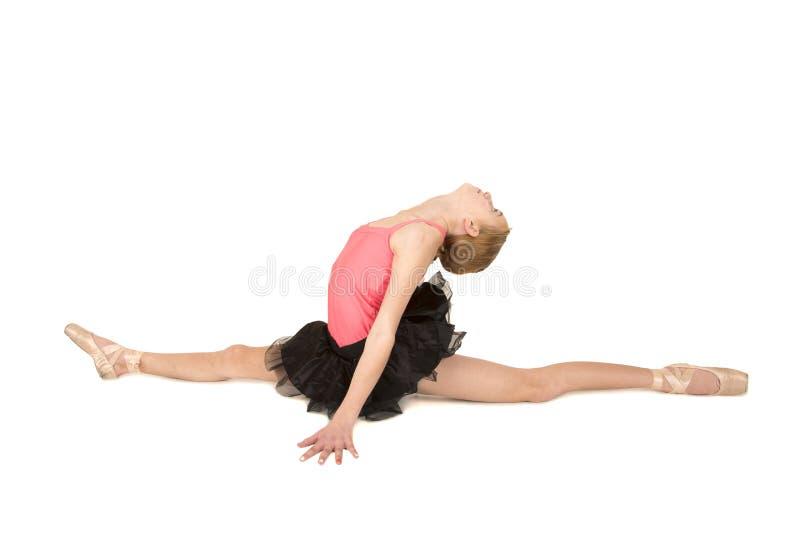 Elegante ballerina die de spleten met hoofdrug doen royalty-vrije stock fotografie