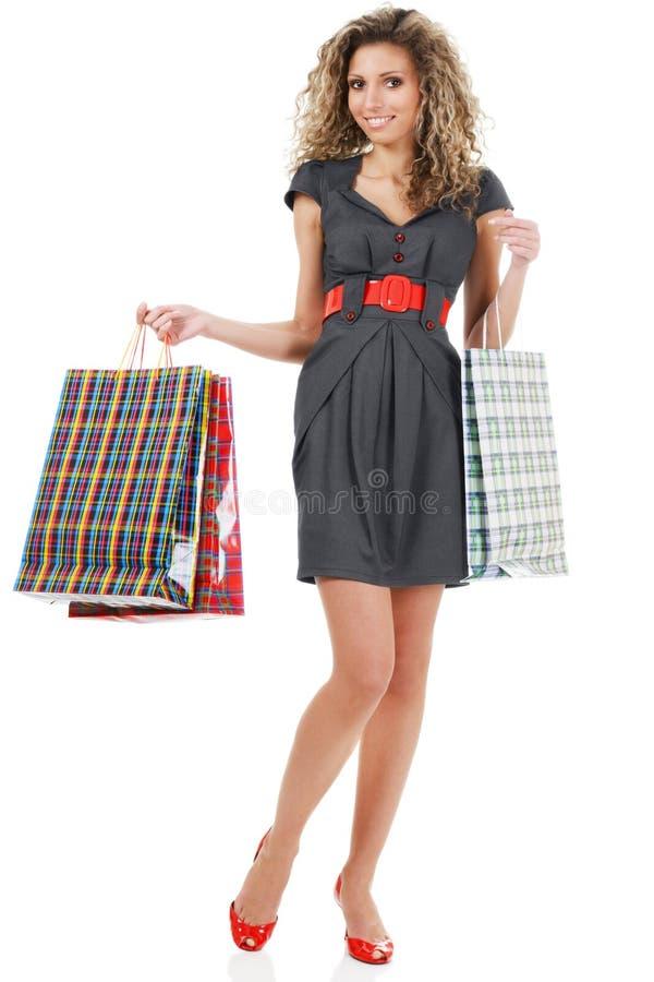 Elegante Frau mit Einkaufenbeuteln lizenzfreies stockbild