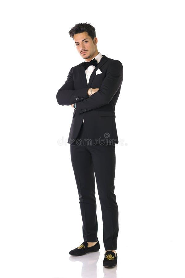 Elegante jonge mens met volledig kostuum en vlinderdas, royalty-vrije stock foto's