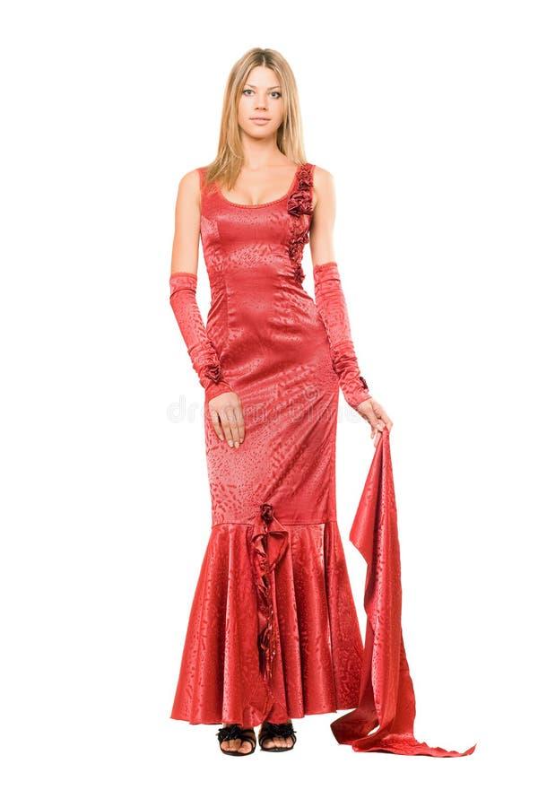 Elegante junge Blondine im roten Kleid lizenzfreie stockbilder