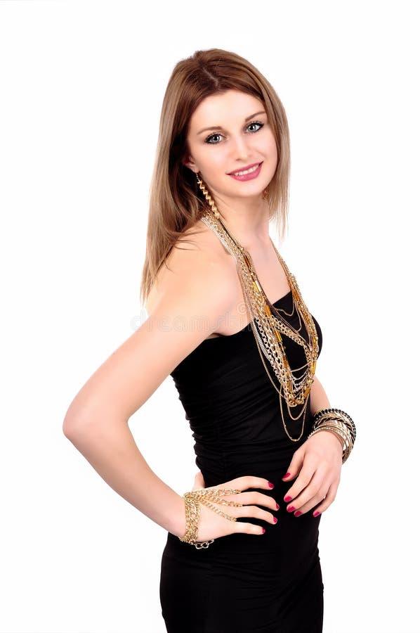 Elegante moderne Frau mit Schmuck auf einem weißen Hintergrund stockfoto