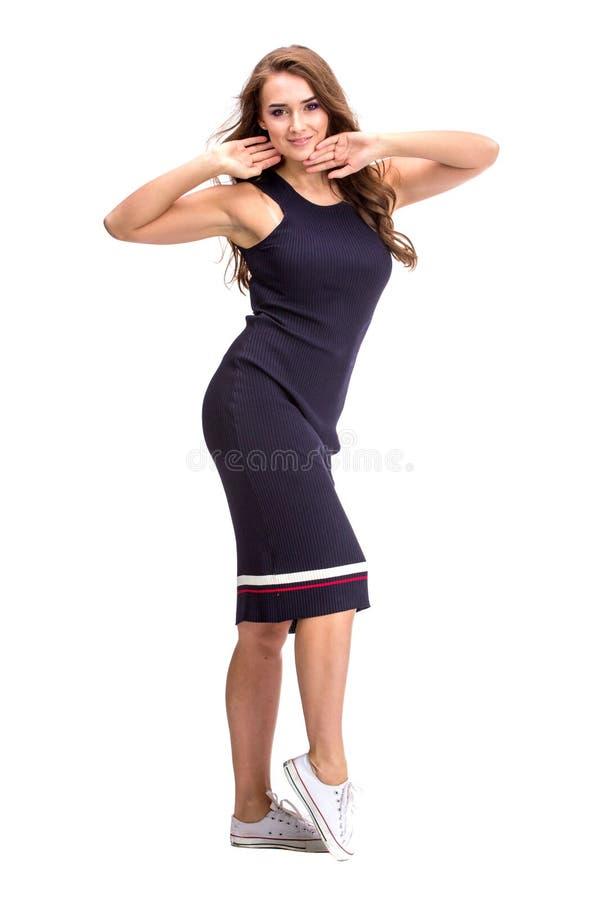 Elegante modieuze vrouw in blauwe kleding stock afbeeldingen