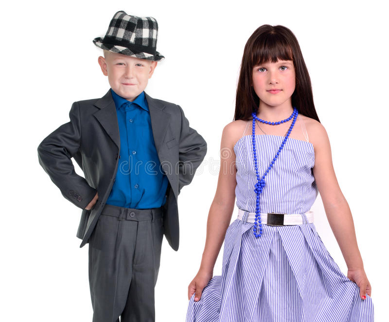 Elegante Paare - kleines Mädchen und Junge lizenzfreies stockfoto